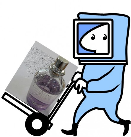 Picture of man in protective suit pushing a trolley with a perfume bottle on it