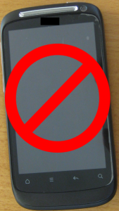 Photograph of a smart phone with a no entry sign on top of it