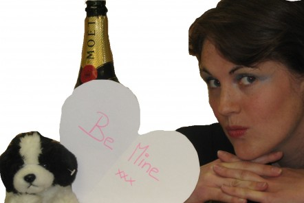 Woman posing with cuddly toy and champagne to mimic photoshoot