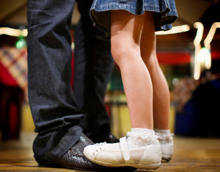 Girl dancing on her dad's feet