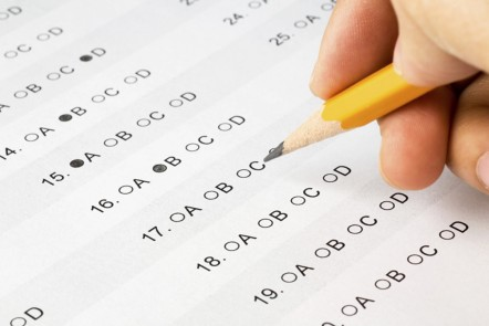 Multiple choice answer sheet being filled in with a pencil