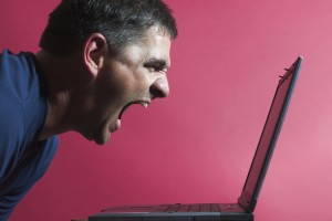 Man shouting at a laptop