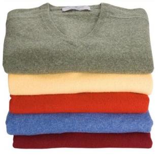 A stack of coloured v neck jumpers
