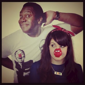 Blogger CTS with a red nose on standing in front of a picture of Lenny Henry.