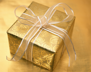 Box wrapped in gold paper with a gold ribbon